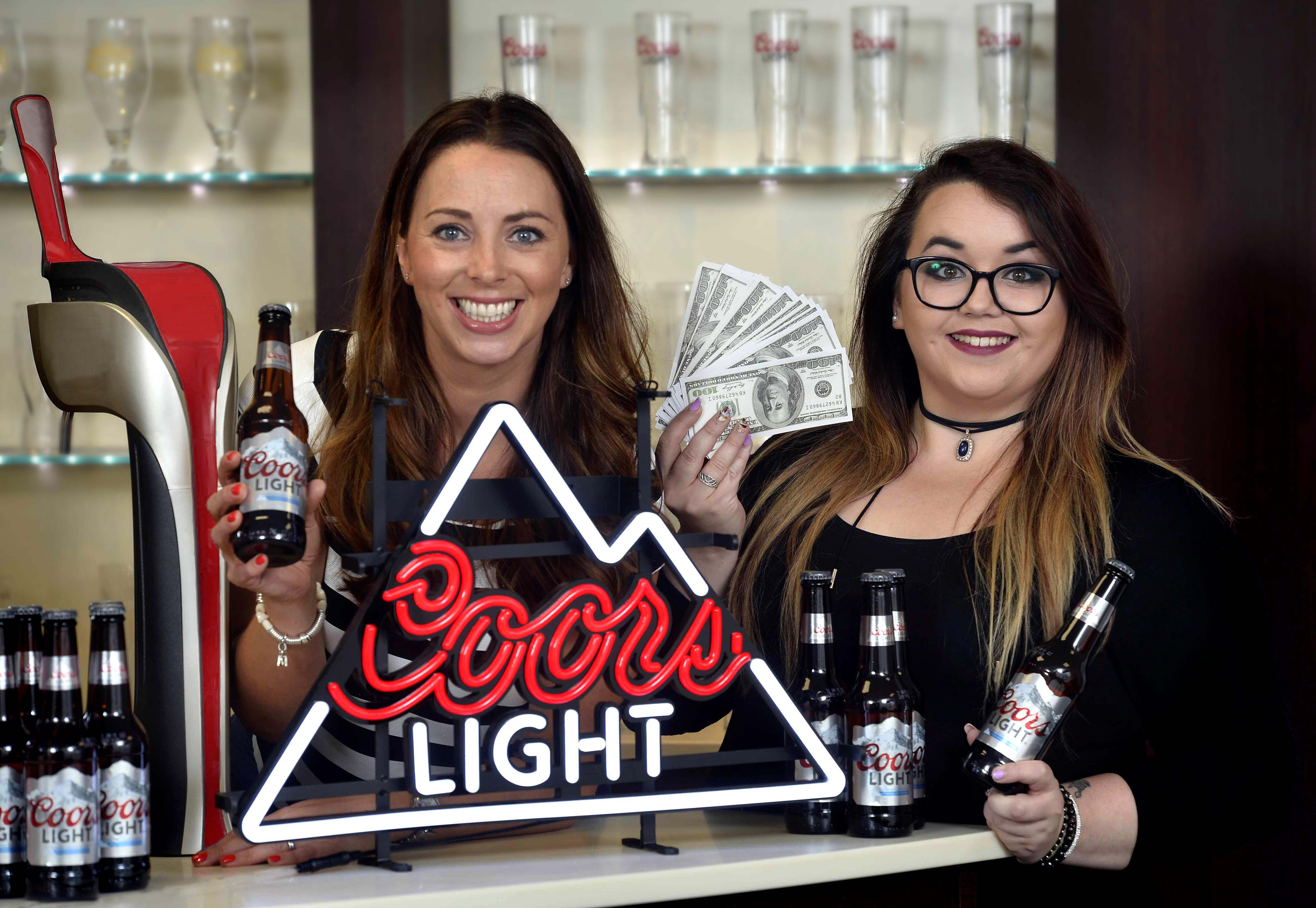 ROAD TRIP: NI photographer, Danielle Whitehouse (r), celebrates with Molson Coors Customer Marketing Manager, Denise Catney, after winning a massive £10,000 competition organised by Coors Light. Danielle was chosen from thousands of entrants who were asked to share what was on their wish list of dream experiences for a chance to turn that dream into a reality. Armed with a £10,000 prize fund, courtesy of Coors Light, Danielle is planning on taking a road trip across the USA in a yellow Chevrolet and stopping at each state on the way to meet the locals and soak up the American culture.