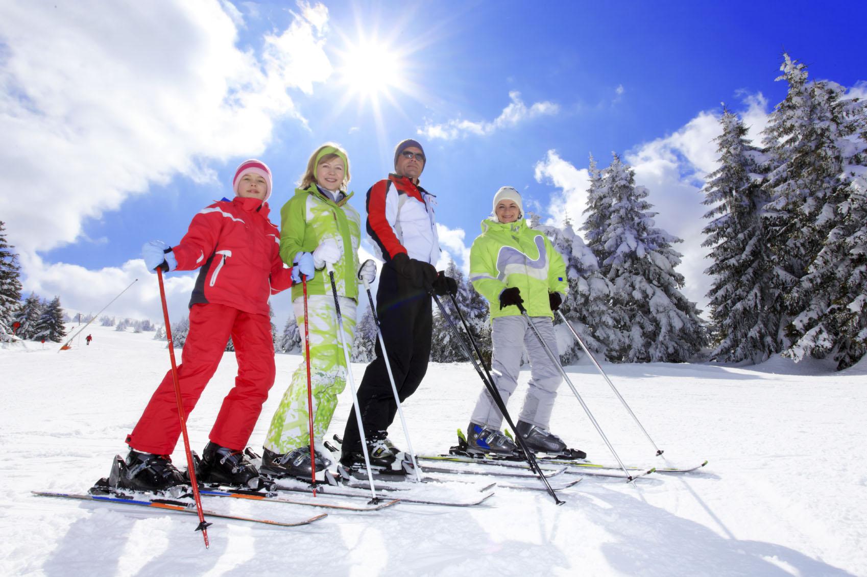 Happy family resting on ski resort.