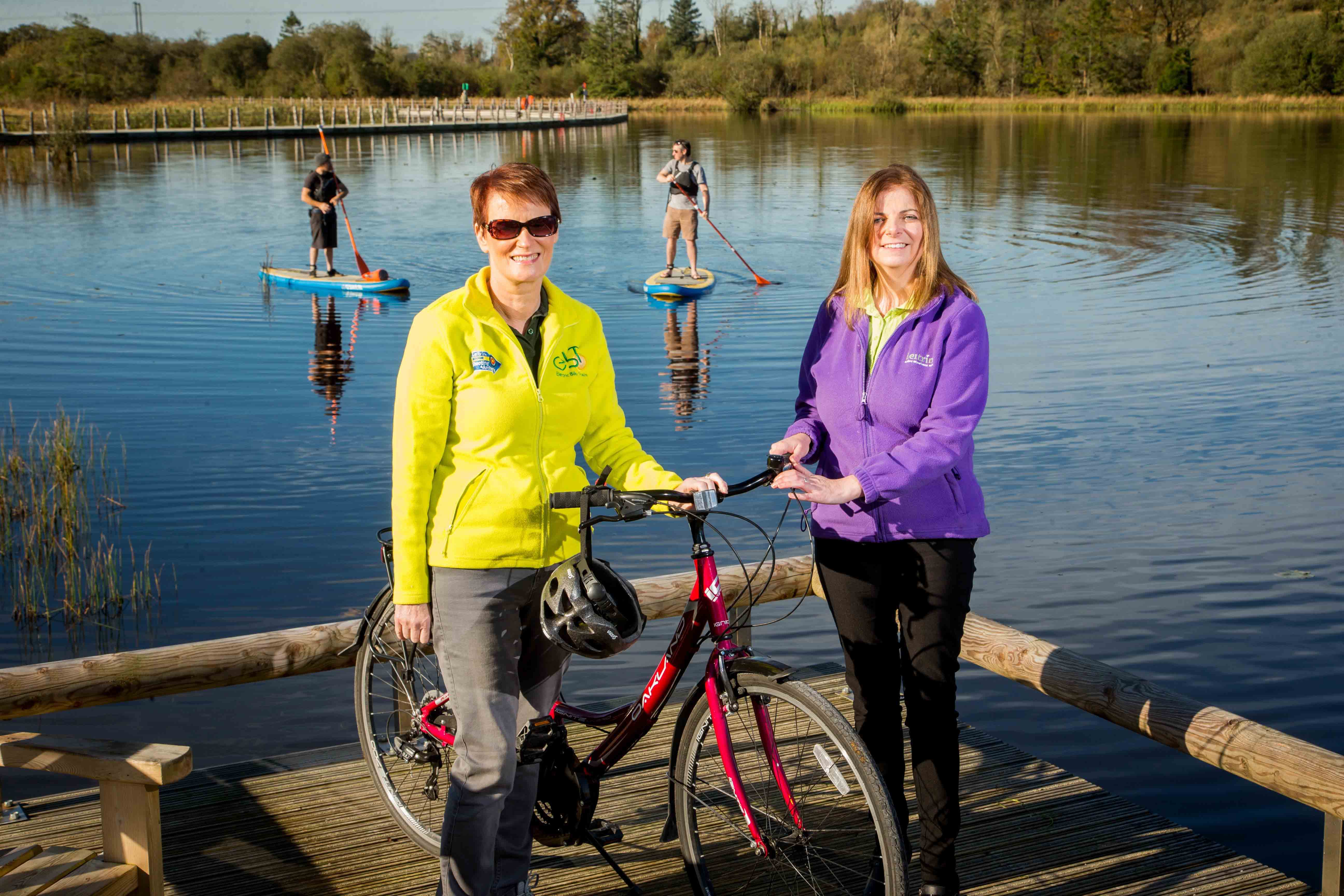 LIFE IN THE SLOW LANE: Eileen Gibbons from Leitrim Cycle Trails (left) and Leitrim Tourism Officer Sinead McDermott (right), pictured at Acres Lake in Drumshanbo, are helping to put County Leitrim on the map as Ireland's home of Slow Adventure, a new concept in tourism that encourages people to slow down and immerse themselves in their experience. With its rural locations and unspoiled landscapes, Leitrim is leading the way in Slow Adventure Tourism, which is all about replacing those adrenalin-pumping, quick fix adventure hits with a slower more immersive experience in which visitors can learn more about the local environment, food and wildlife whilst taking part in an activity. Over the past two years, Leitrim Tourism has been working with local providers, as part of a European-wide research programme, to develop an array of packages and experiences to meet the criteria and principles of the Slow Adventure Trademark and appeal to visitors who prefer life in the slow lane. More details can be found at http://slowadventure.ie/.