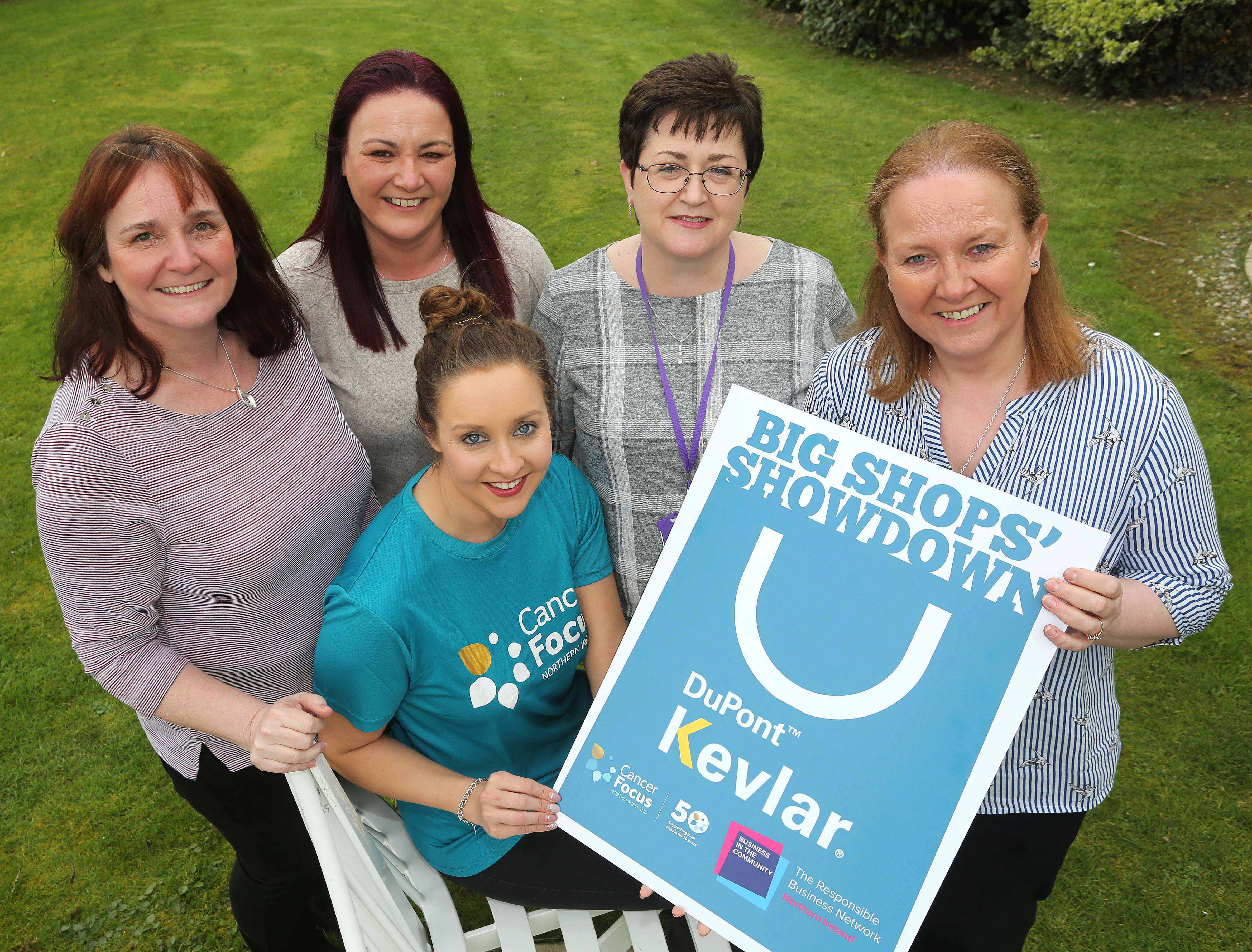 BIG SHOPS' SHOWDOWN: (L-R Standing) Karen Dornan, Janine Geddes, Helena McGuinness, and Anita Simpson from DuPont are joined by Louise Greer (front-centre) from Cancer Focus NI to announce that DuPont will be swapping Maydown for Limavady for a day on Friday April 12th, when their team takes over the Cancer Focus Northern Ireland charity shop on Connell Street as part of Business in the Community's 'Big Shops' Showdown' fundraising initiative. The Big Shops' Showdown will see companies across Northern Ireland take over the running of a Cancer Focus shop for the day, and compete against each other to raise as much cash as possible for the charity. Maydown-based DuPont has been getting creative in their fundraising; organising coffee mornings, a quiz and planning activities for the Limavady shop on the day. Their team has big plans to get people involved, and are encouraging everyone in the area to pop into the Cancer Focus NI store between 10am-4pm on Friday April 12 to help support the local charity.