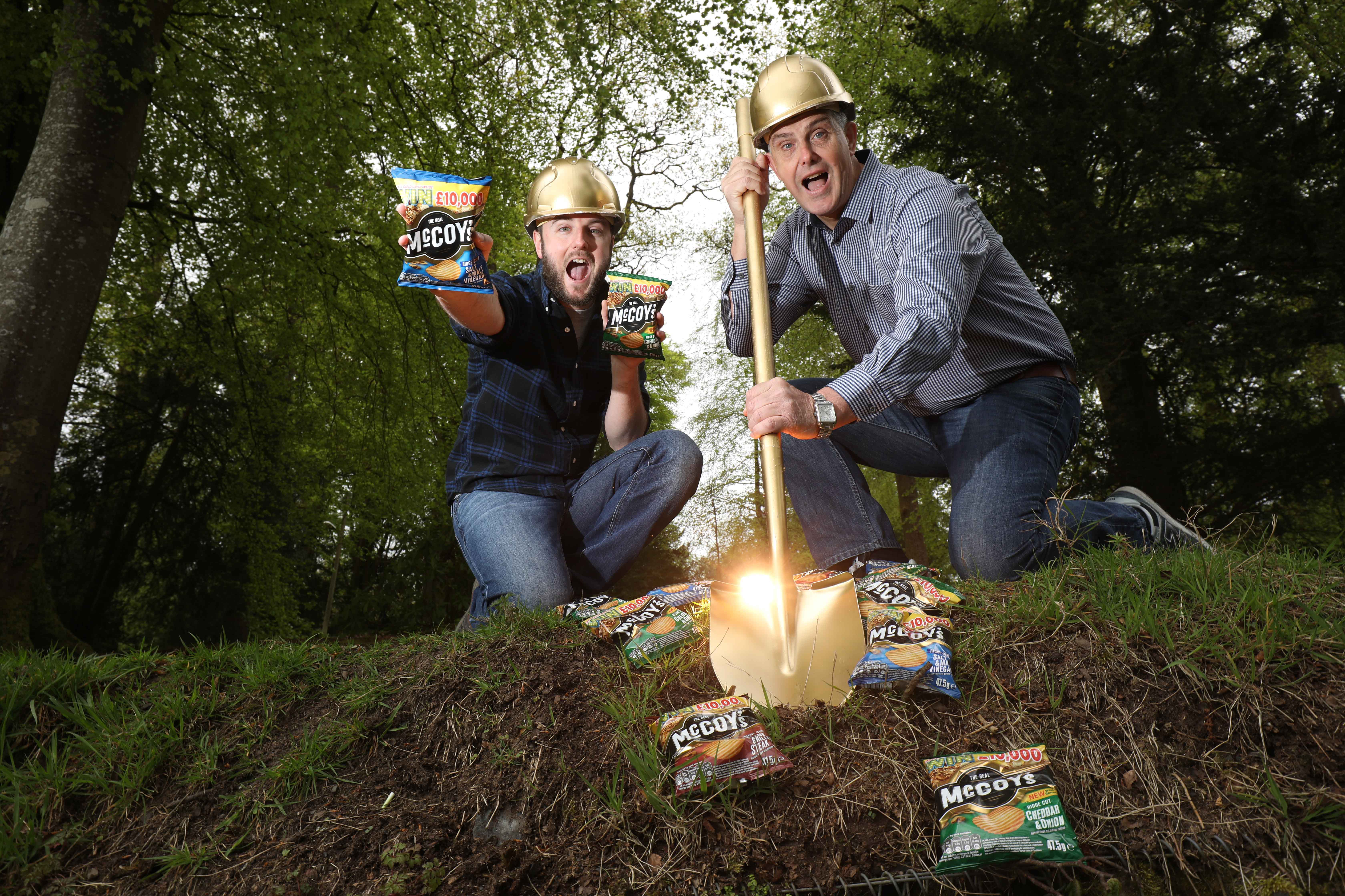 THERE'S GOLD IN THEM THAR CRISPS: John Baxter and Ricky Watts from KP Snacks launch McCoy's Crisps' brand new national 'Dig For Gold' campaign. Ten golden crisps, each worth a tasty £10,000, will be hidden in ten random packs of McCoy's, the best-selling ridged crisp in Northern Ireland, between now and July 31. In addition to people winning a very tasty amount of money, charities across the UK will benefit as the retailers that sell the winning golden crisp bags will each donate £1,000 to a charity of their choice. The golden crisps can be found in 'Dig For Gold' branded packs of McCoy's Flame Grilled Steak, Salt & Vinegar, Cheddar and Onion, Mexican Chilli, Sizzling King Prawn, Thai Sweet Chicken along with McCoy's Chips Salt and Vinegar and Curry Sauce.