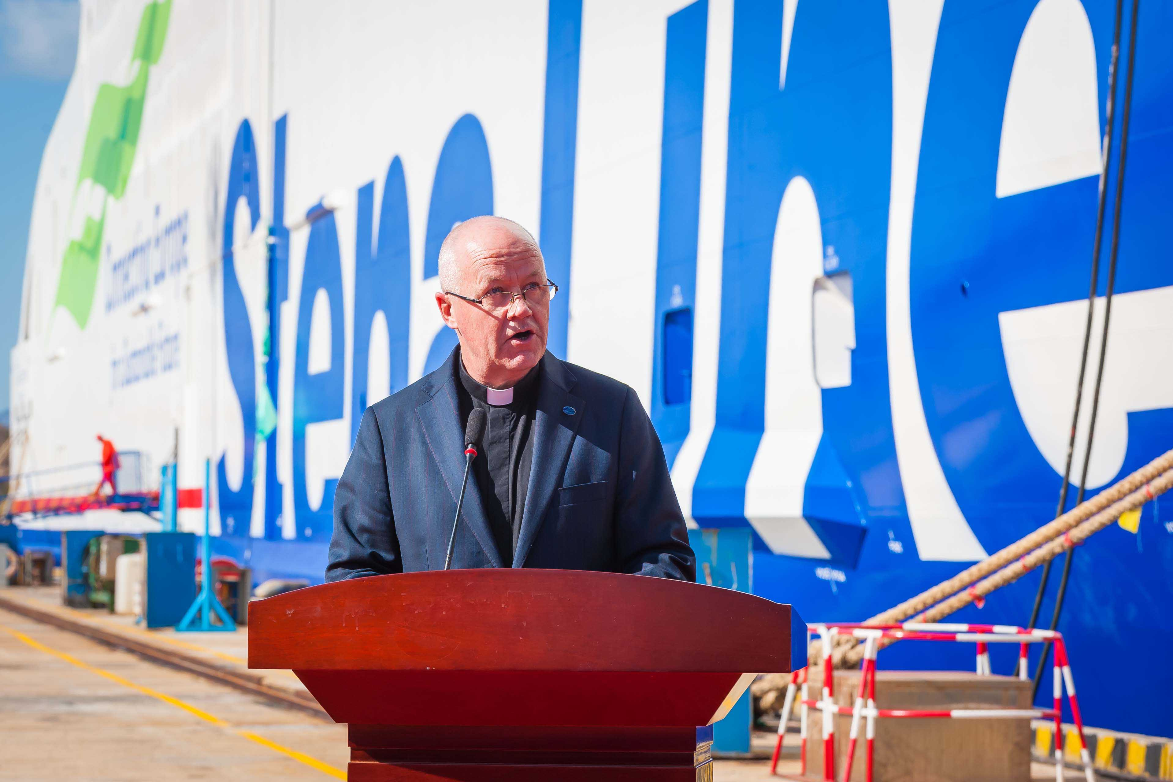 Reverend Stephen Miller, Senior Chaplain at the Mission to Seafarers, based in Hong Kong, blesses the Stena Estrid at the signing ceremony for Stena Line's newest ferry
