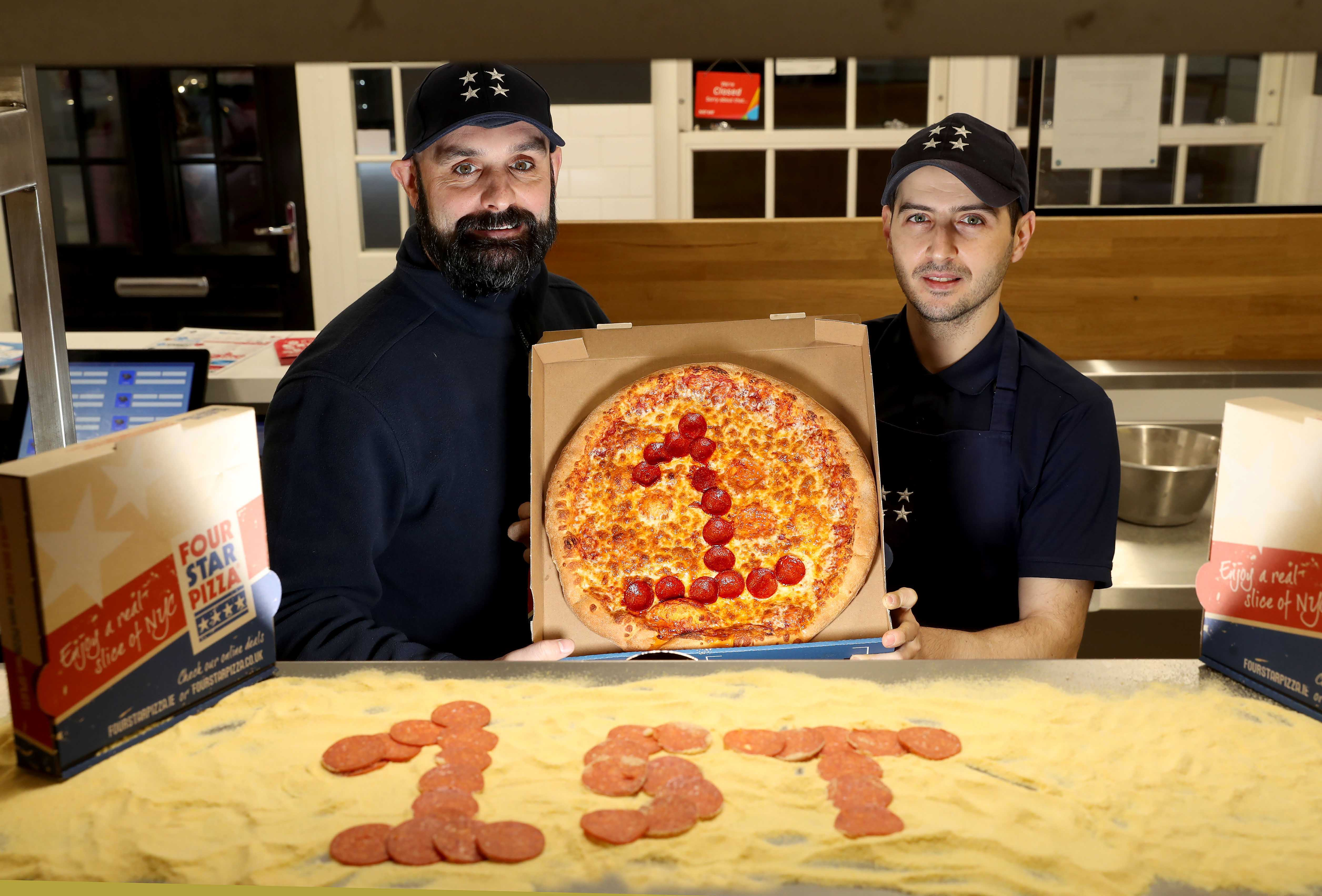 Scott Higginson (left) and Okan Turan of Four Star Pizza in Lisburn serve up a celebratory pizza to mark the store's first birthday. It's been a very successful year for the popular store which opened on the Nettlehill Road in December last year, creating 25 jobs in a £150,000 investment by the Irish-owned pizza chain. Since then, it has delivered no fewer than 82,000 fresh pizzas to homes in the Lisburn area, using OVER ONE MILLION pepperoni slices, 10 TONNES of cheese and 17 TONNES of flour. So successful has the Lisburn store been that, from January 1, 2020, it will be opening from 12 noon every day to meet the lunchtime demand. Four Star Pizza was established in 1988, and operates 57 stores across the island of Ireland, including 13 in Northern Ireland. It is renowned for its pizza dough which is freshly prepared by hand on site daily by passionate and expertly trained pizza chefs, using top quality locally sourced flour. For more information go to https://fourstarpizza.co.uk/