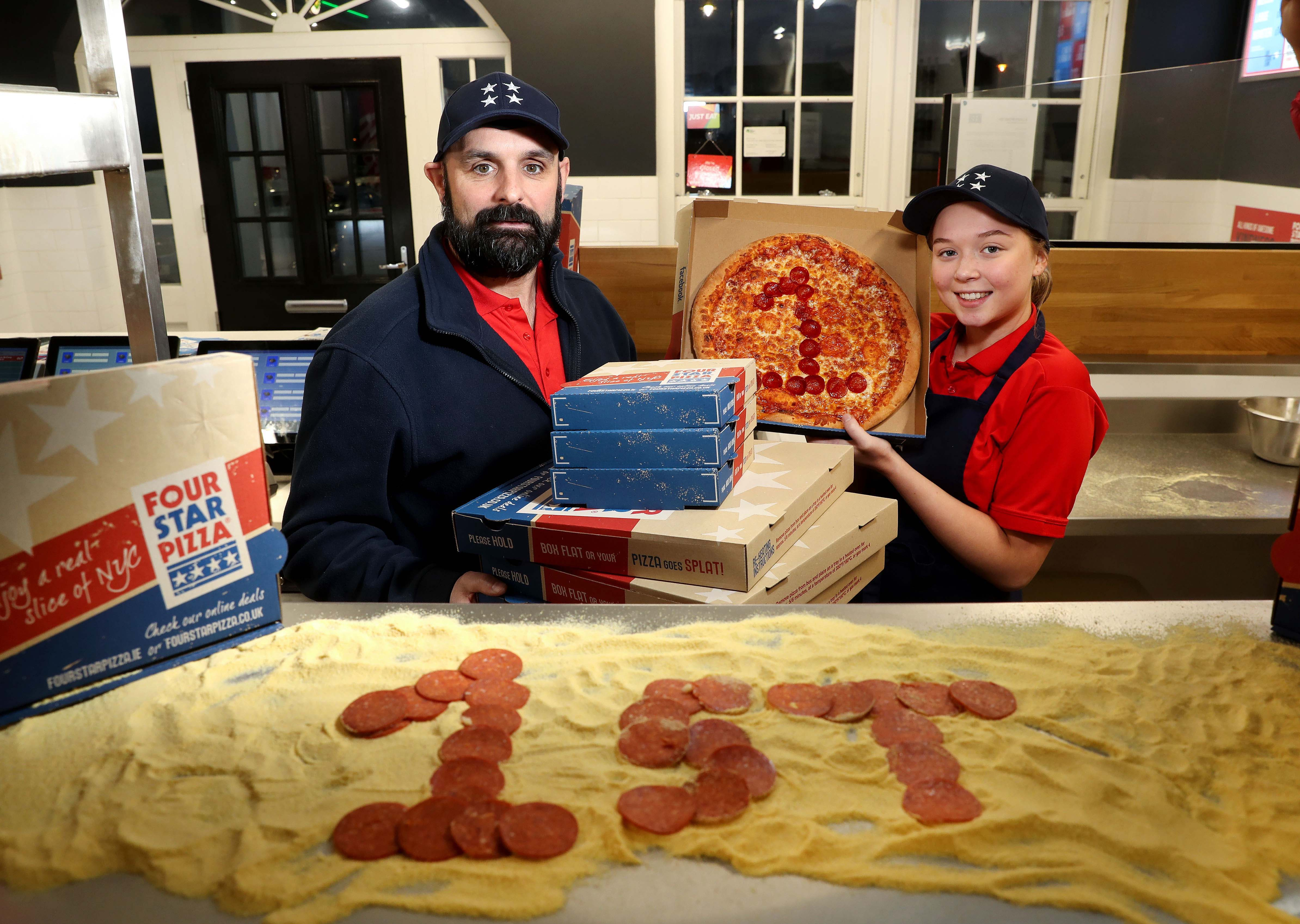 Scott Higginson (left) and Sinead Smiley of Four Star Pizza in Lisburn serve up a celebratory pizza to mark the store's first birthday. It's been a very successful year for the popular store which opened on the Nettlehill Road in December last year, creating 25 jobs in a £150,000 investment by the Irish-owned pizza chain. Since then, it has delivered no fewer than 82,000 fresh pizzas to homes in the Lisburn area, using OVER ONE MILLION pepperoni slices, 10 TONNES of cheese and 17 TONNES of flour. So successful has the Lisburn store been that, from January 1, 2020, it will be opening from 12 noon every day to meet the lunchtime demand. Four Star Pizza was established in 1988, and operates 57 stores across the island of Ireland, including 13 in Northern Ireland. It is renowned for its pizza dough which is freshly prepared by hand on site daily by passionate and expertly trained pizza chefs, using top quality locally sourced flour. For more information go to https://fourstarpizza.co.uk/