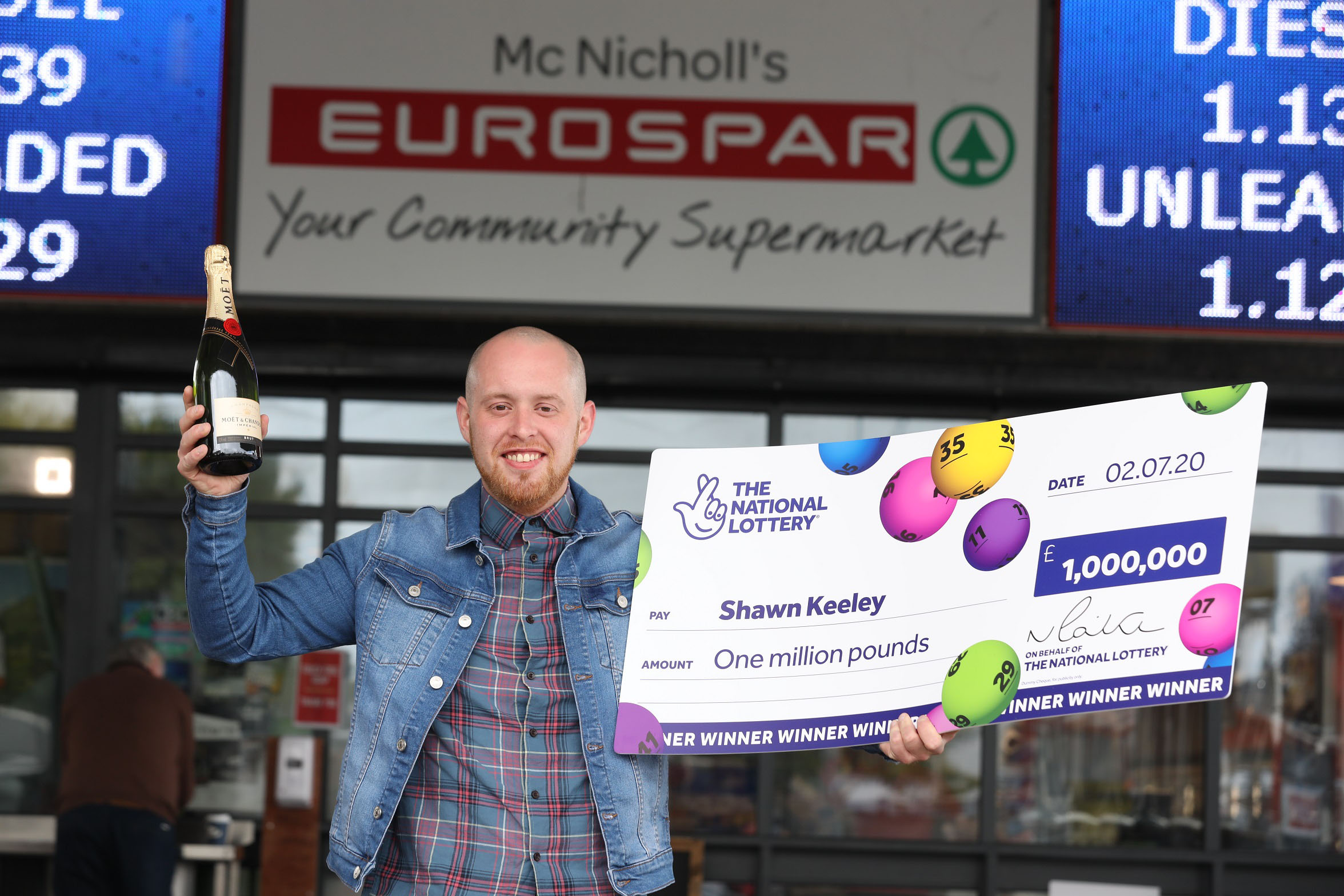 THANKS A MILLION!: Shawn Keeley (26) from Dungiven celebrates becoming Northern Ireland's latest National Lottery millionaire - after winning a massive £1,000,000 on a National Lottery Scratchcard. Shawn bought the winning National Lottery '£50M Mega Cash Showdown' Scratchcard from McNicholl's Eurospar store at 39 Station Road, Dungiven, BT47 4LN. The card costs £5 and offers a 1 in 3.51 overall chance of winning a prize, with prizes ranging from £5 up to the top prize of £1,000,000.