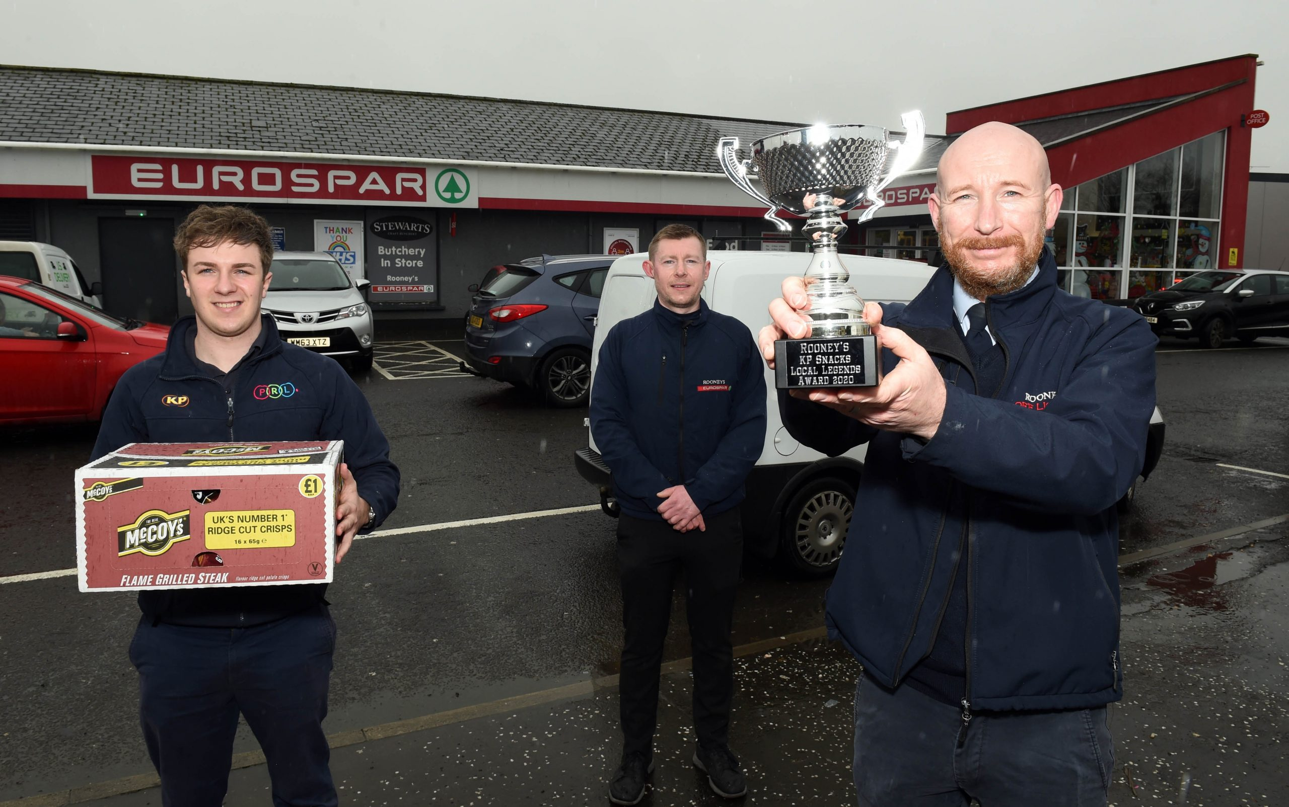 Sam Gordon from KP Snacks with James and Timmy Rooney from Rooney's EUROSPAR, Enniskillen, Co Fermanagh