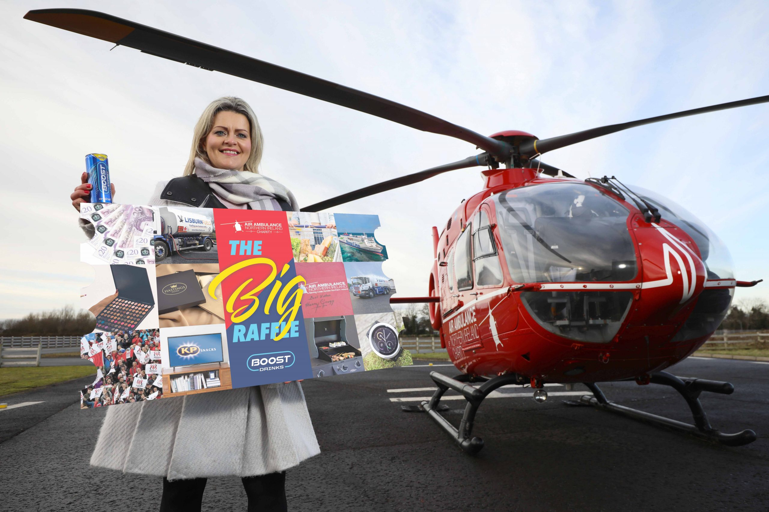 SPECTACUL-AIR RAFFLE TO RAISE FUNDS FOR AANI: Life-saving charity Air Ambulance Northern Ireland (AANI) and partner Boost Drinks are aiming to cheer everyone up this gloomy January and raise essential funds by launching an incredible raffle worth thousands of pounds. The Big Raffle tickets can be purchased via www.airambulanceni.org/thebigraffle/ for a chance to win amazing prizes from as little as £1. Colleen Milligan, Area Fundraising Manager at AANI, launches the raffle at the AANI base in Lisburn.