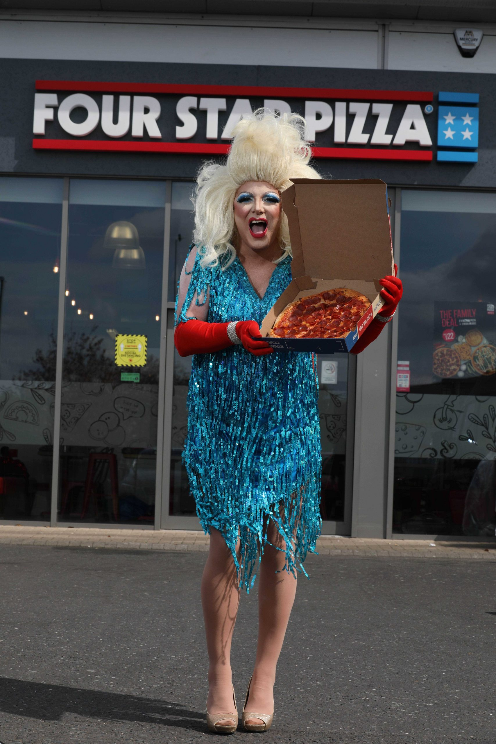 """Pizza fanatic, Alfie Parker (38), a mechanic from Belfast, had no idea when he responded to a message from his favourite pizza takeaway, that he would become Northern Ireland's latest Drag Queen, Anita Pizza, following a makeover by NI Drag Queen royalty, Trudy Scrumptious! Alfie, aka Anita Pizza, said: """"I didn't think my love of Four Star Pizza would lead me down this path, and in heels, but my outlook on life is that you only live once, so after discussing it with my wife, Isobel, and daughter Brianna, I decided to give it a go."""" Brian Clarke, Director at Four Star Pizza, explained: """"We wanted to do something a bit different for the launch of our new pizzas; everyone knows how amazing our pizzas are, it wasn't about that, we just wanted to stop our customers in their tracks with something surprising that would put a smile on their faces."""" Visit www.fourstarpizza.co.uk for more information and details of their new menu."""
