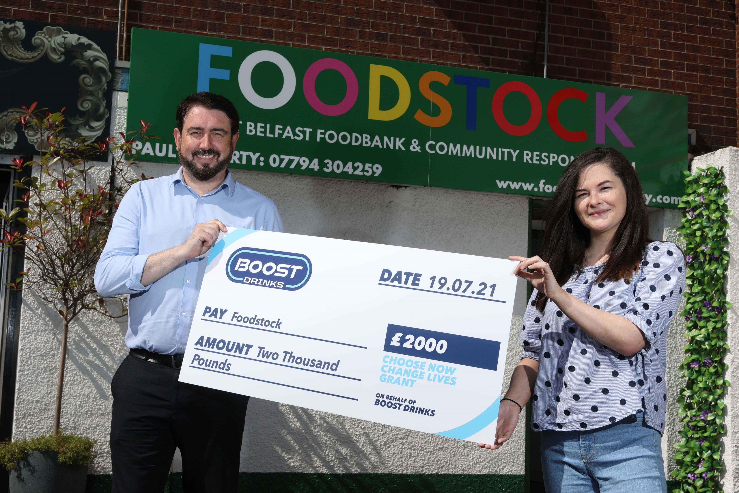 Boost Drinks, the owner of Northern Ireland's best-selling soft drink within the local independent convenience channel*, has announced that Foodstock in west Belfast, Dramability in Downpatrick and Ballykelly Men's Shed, are the first community groups to receive a share of its Choose Now, Change Lives, £10k fund. Pictured receiving their cheque for £2000 is Paul Doherty and Orlagh Craig from Foodstock. The second round of the grant awards is currently underway, and the third burst will take place later this year, allowing six more incredible community groups in Northern Ireland to receive a donation from the Boost Drinks 'Choose Now, Change Lives' fund. There's still time to nominate a group or project that needs some help, please fill out a nomination form at www.boostdrinks.com/changelivesni. * Source: IRI Marketplace Data, Symbols & Independents, Unit Sales w/e 27.12.20