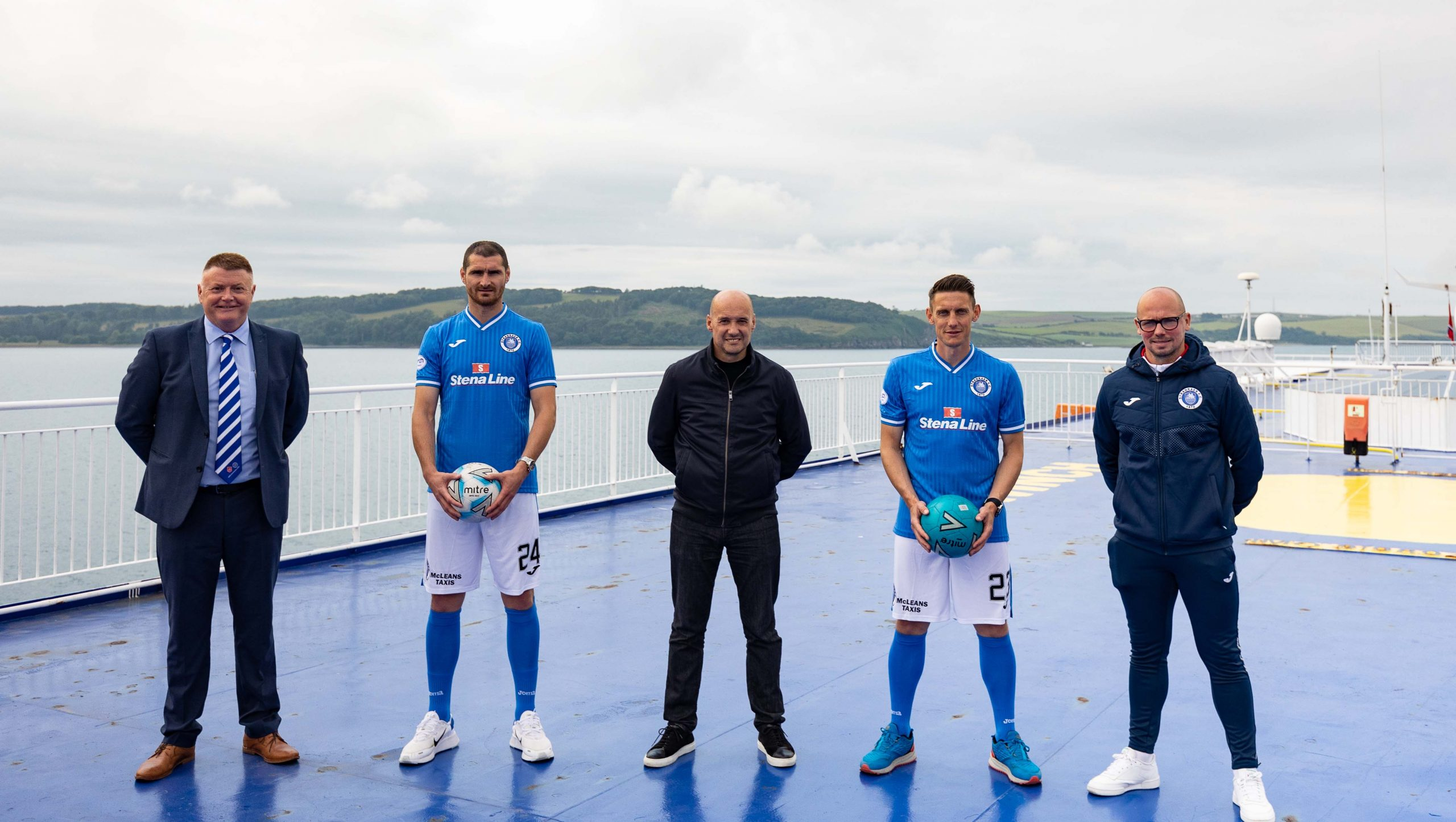 FERRY GOOD DEAL: The longest unbroken sponsorship deal in British professional football history is to continue for a staggering 34th consecutive season after ferry company Stena Line renewed its partnership with Scottish League Two side Stranraer Football Club. Stena Line's long-running association with Stranraer FC 'kicked off' in 1988 and has lasted longer than any other sponsorship out of all the English, Scottish and Welsh professional football leagues. Celebrating the renewal of the sponsorship on top of the Superfast VII ferry are Stena Line PR & Communications Manager Simon Palmer (centre) with Stranraer FC Vice Chairman Robert H Rice, first team players Darryl Duffy and Scott Robertson, and team manager Jamie Hamill.